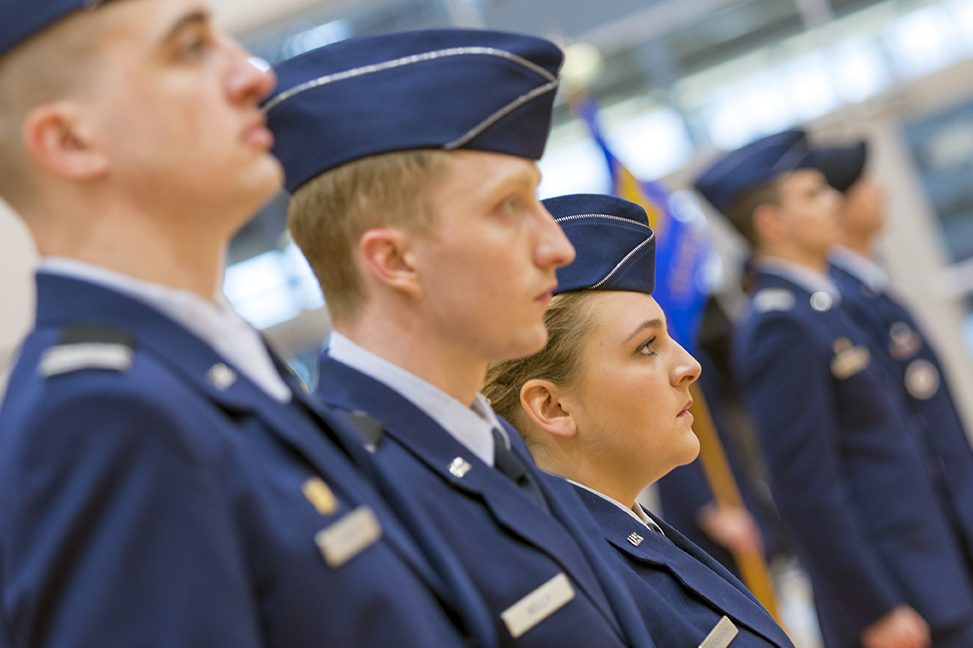 Profile of three Air Force ROTC cadets in blue uniforms.