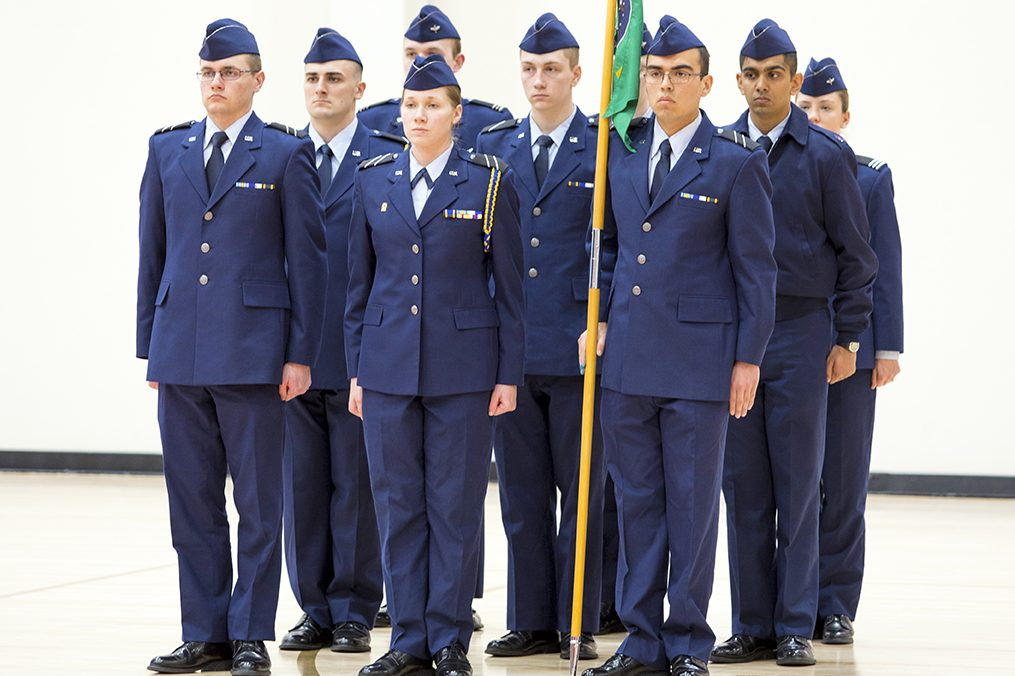 Air Force ROTC cadets standing with flag at Air Force ceremony.