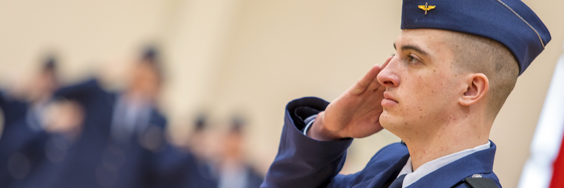 Air Force ROTC cadet saluting during ceremony.