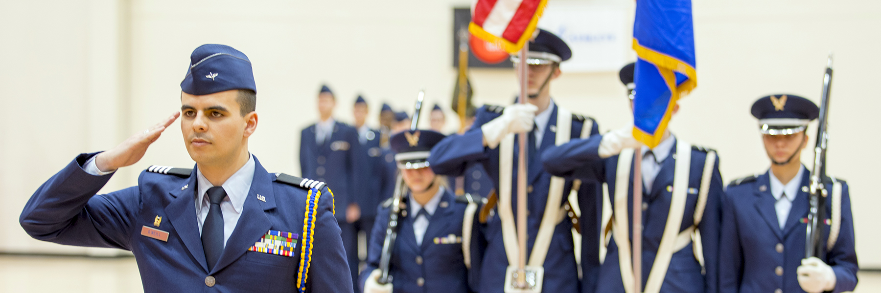 Air Force ROTC cadets standing at attention during ceremony.