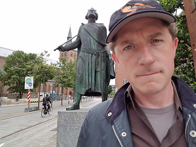Professor Leson with a statue of Saint Canute.