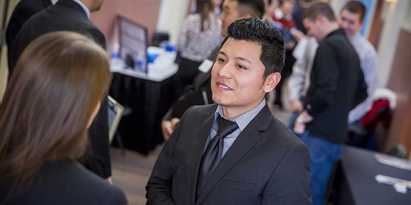Male Student Speaking with Employer