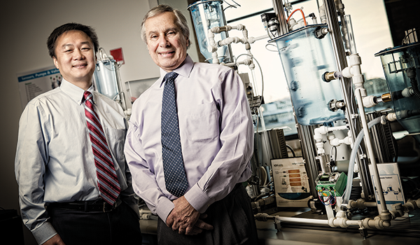 photo of Professor Junhong Chen & Dean David Garman in a lab