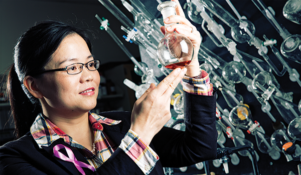 Assistant Professor Xiaohua Peng in a lab