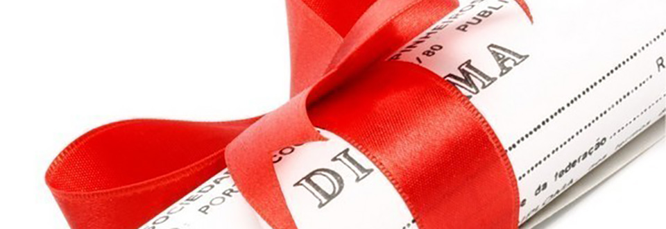 Image of a diploma wrapped with a red ribbon.