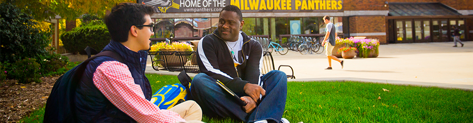 UWM students sitting outside the campus union.