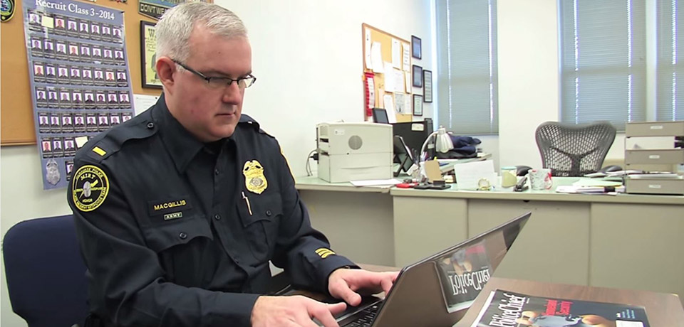Lt. James MacGillis, program manager for the Milwaukee Police Academy, works on his laptop.