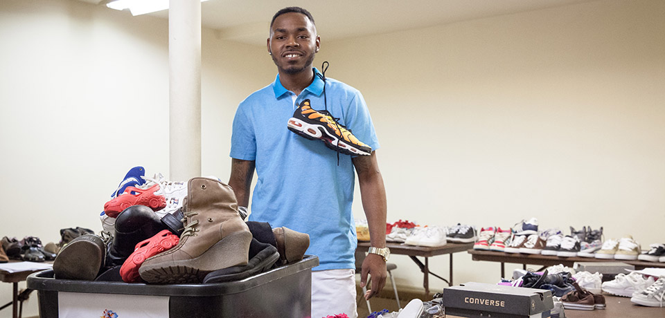 Jacarrie Carr and his collection of refurbished shoes for those in the community who can't afford them.
