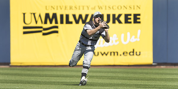 Sam Koenig, School of Education senior baseball player for the University of Wisconsin-Milwaukee, makes a catch in the outfield during a game this season.