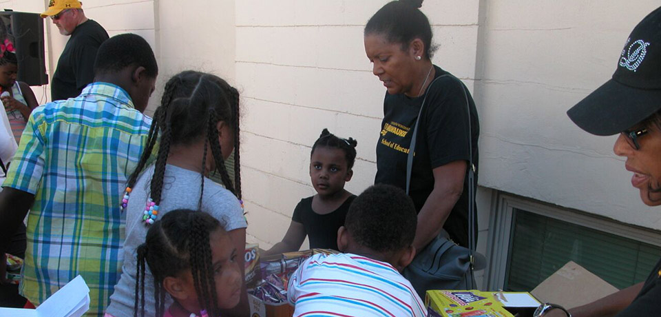 SOE faculty member Deborah Blanks and other volunteers help to give away shoes to those in need.