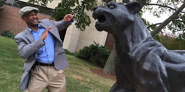 SOE faculty Larry Martin having fun with the UWM Panther. Photo by Simone C. O. Conceição