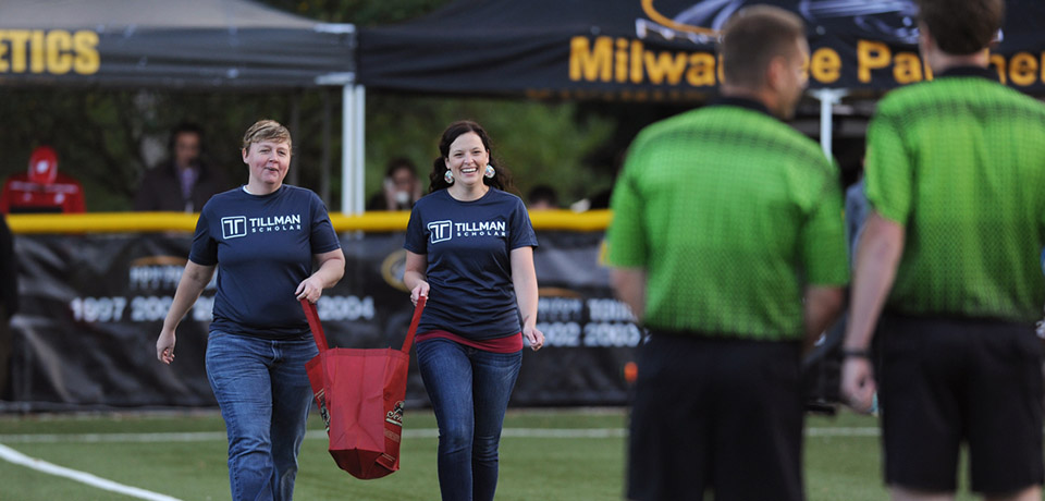 Tillman Scholars Halli Stewart, left, and Rae Anne Frey were recognized before a September UWM soccer match on the 14th anniversary of the Sept. 11 terrorist attacks.