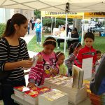 Visitors looking for books at the Math Blast event.