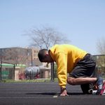 Educational Studies major Marquis Johnson getting in position to sprint during track practice.