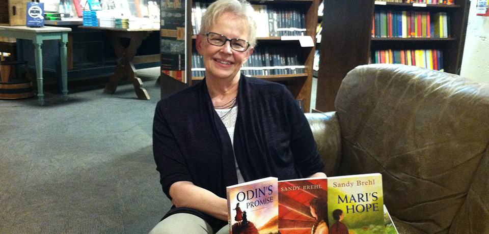 SOE Alumna and author Sandy Brehl displaying her books.