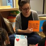 School Psychology graduate student Rachael Koppel reads to students in the Next Door Head Start program.