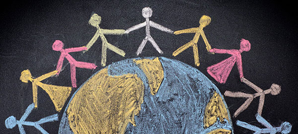 Hand drawn chalk image of children holding hands around the globe.