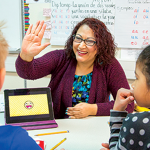 Josefina Regalado Valdes, works with students in her classroom.