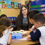 Guadalupe Rodriguez works with children in her classroom.