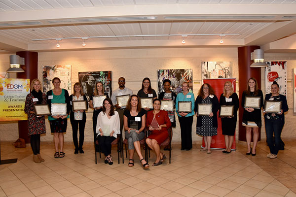 These are the teachers who were nominated for their work in special education. From UWM are Heidi Ann Hamilton (center front) who earned her teaching certification. In the back row, Krishana Robinson (6th from left) and Kimarie Bruessel (8th from left), both of whom earned their master's in exceptional education.