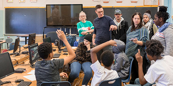 CLUBS students working with their teacher in the computer lab.