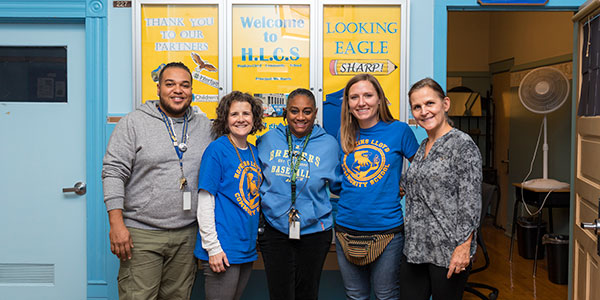 CLUBS, Community Learning Unique to our Building and Students team poses for a photo.
