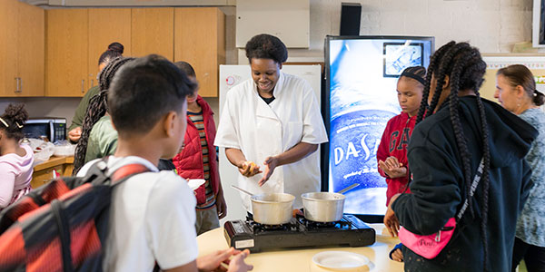 CLUBS students look on during cooking session.