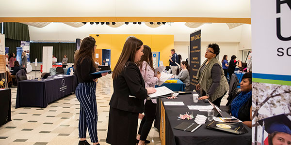 Students gathering information at the 2019 Education Career Fair.