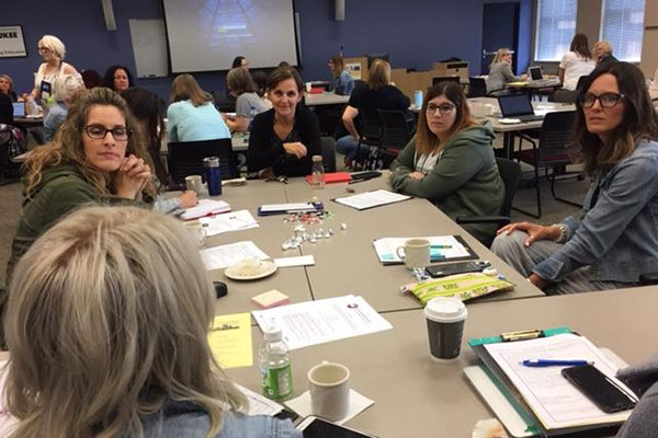 Participants of the 38th Annual Wisconsin Literacy Research Symposium chat during a group discussion.