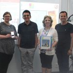 Sarah Johaningsmeir, Dauster Souza Pereira, Paulo Rocha and Simone Conceição display the CareTaker app.
