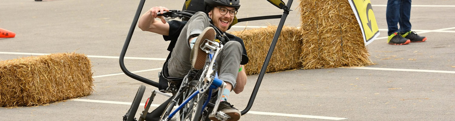 Student riding an engineered bicycle