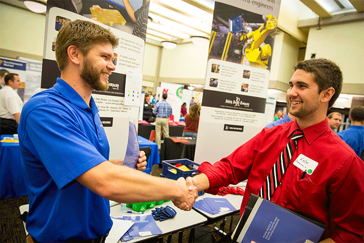 recruiter talking to student at Industry Expo
