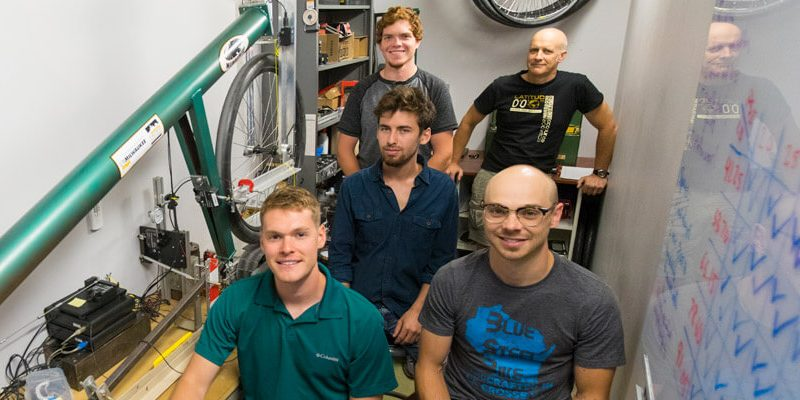 four students and Andy Dressel in bike lab