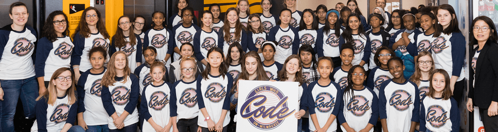 About 70 girls wearing Girls Who Code T-shirts, along with Christine Cheng and student helpers