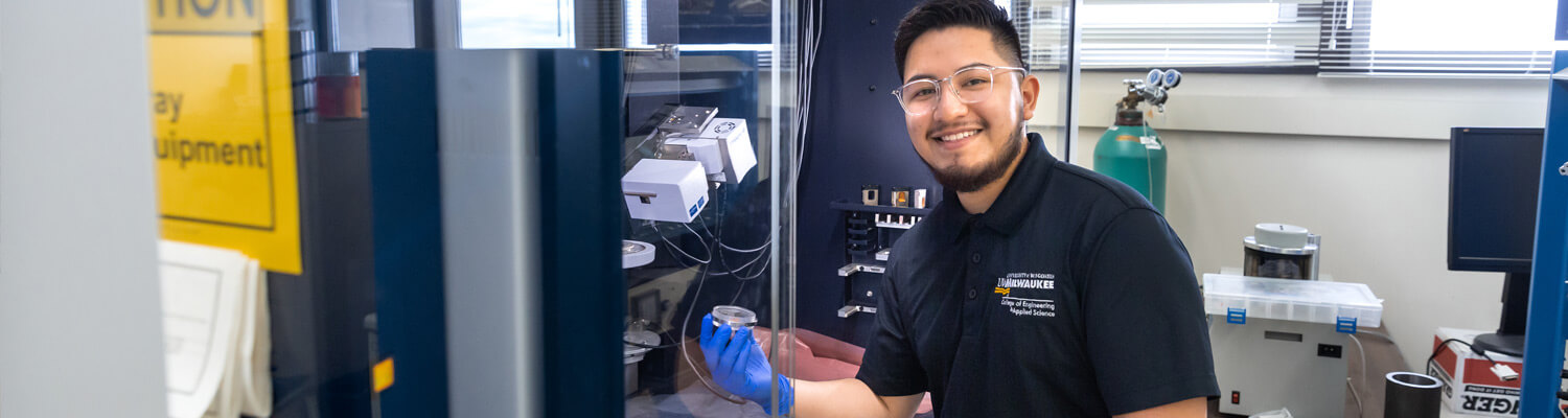 Smiling student in material lab
