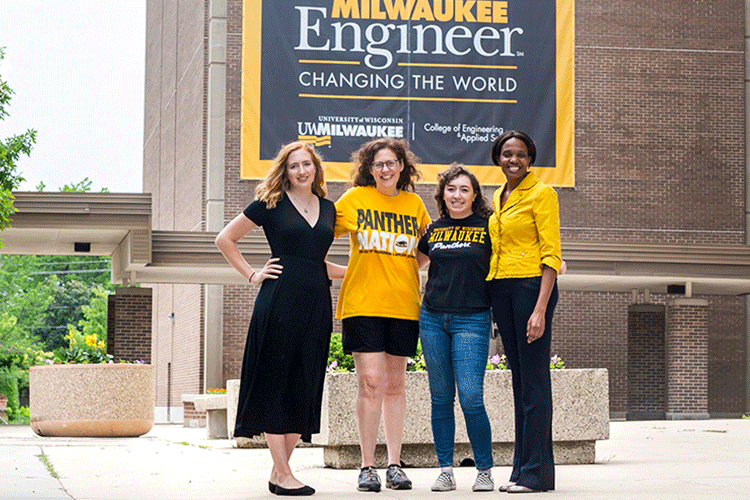 Four women (faculty, staff, students) outside EMS