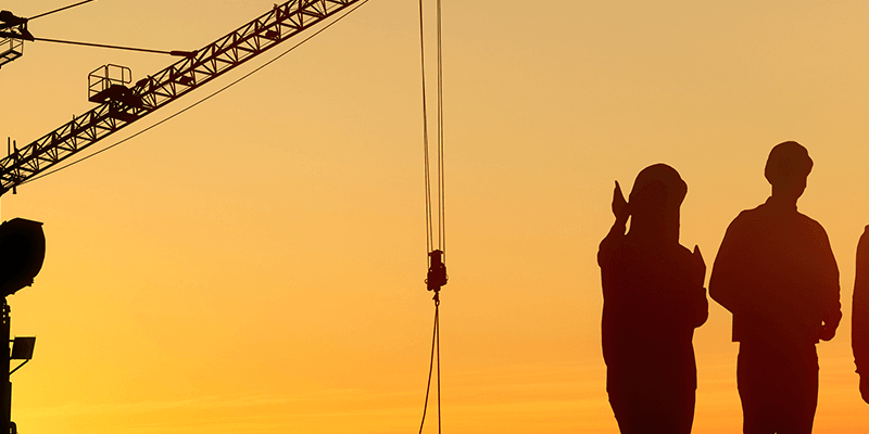 Three silhouttes of workers outside