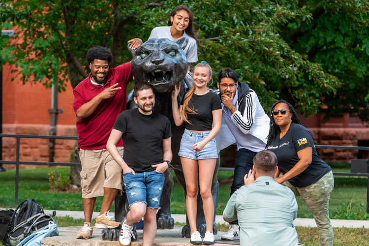 Students on panther statue