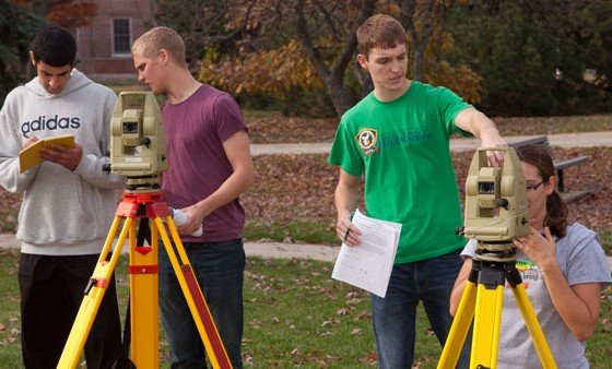Civil engineering students practice surveying techniques