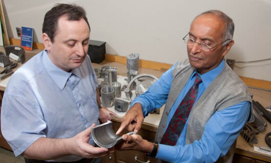 Materials Science Engineering professors Pradeep Rohatgi and Michael Nosonovsky with composite casting.