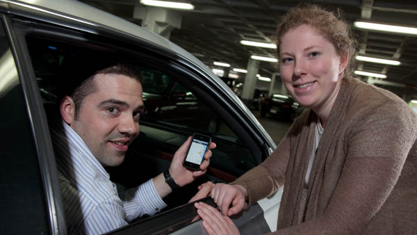 Students Adam Bushman (Engineering) and Kayleigh Rappaport designed a mobile app that reports the availability of parking spaces in UWM parking garages.