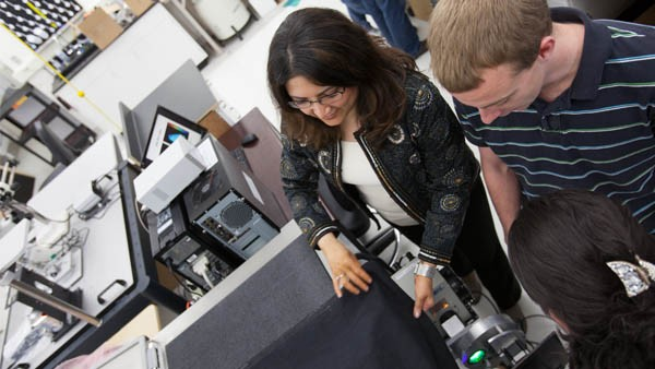 Assistant Professor Mahsa Ranji (Computer Science and Electrical Engineering) and students in the lab. Dr. Ranji has developed a method that uses light, not surgery, for biopsies.