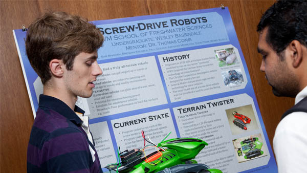 Participants in the UWM Summer Research Program for Undergraduates show their designs.