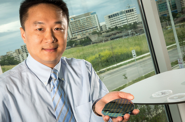 Junhong Chen with water sensors that are now manufactured by three Wisconsin companies. (UWM Photo/Troye Fox)