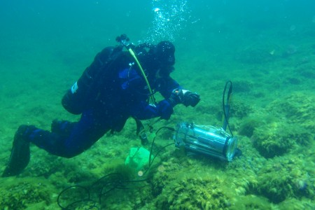 diver collects samples under water in Lake Michigan