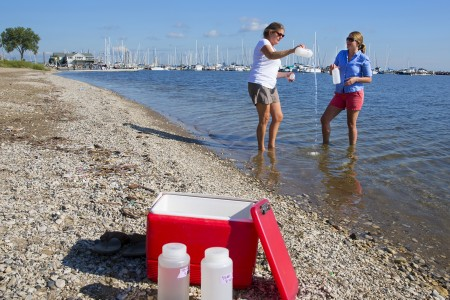 fresh water scientist and graduate student gather samples in Lake Michigan