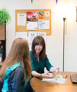 Advisor meets with student in office
