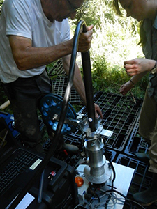 Professor Grundl installing a probe into a borehole at a field site in south central France.