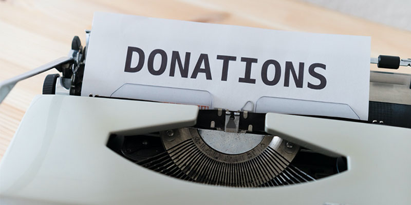 "typewrite with ""donation"" on paper"