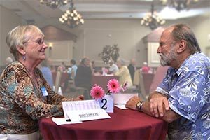 Janice and Pacho at a senior speed dating event